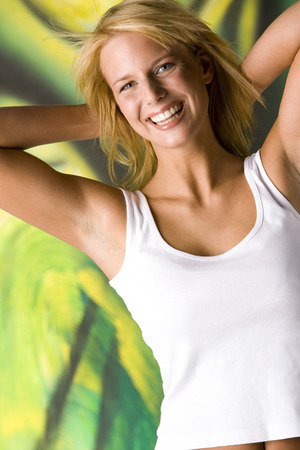 Blond Woman Beaming With Joy Hands Behind Neck