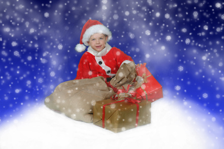 Boy (7-9) Wearing Christmas Outfit, Sitting In Pile Of Gifts LANG_EVOIMAGES
