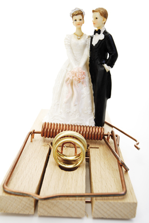Wedding Couple Standing Behind Mouse Trap, Close-Up