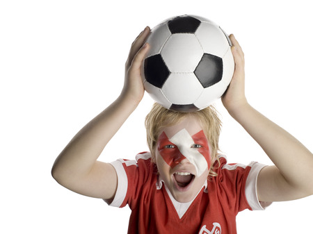 jubilating: Boy (10-13) With Austrian Flag Painted On Face, Holding Football Above Head, Portrait