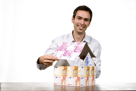 Young Man With House Of Euro Notes, Smiling, Portrait