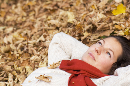Woman Lying On Autumn Leaves, Portrait, Close-Up