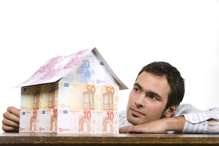Young Man With House Of Euro Notes, Close-Up
