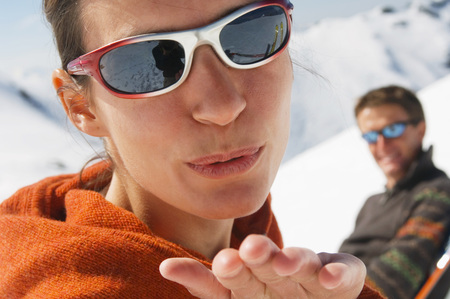 Couple In Mountains, Woman Blowing Kiss