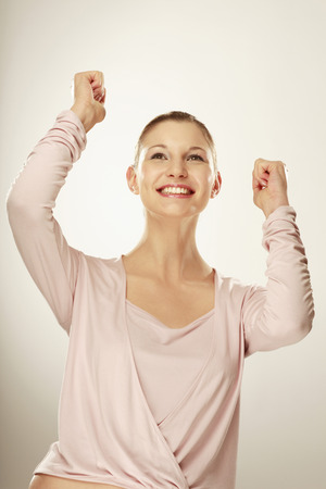 jubilating: Young Woman Smiling, Arms Up