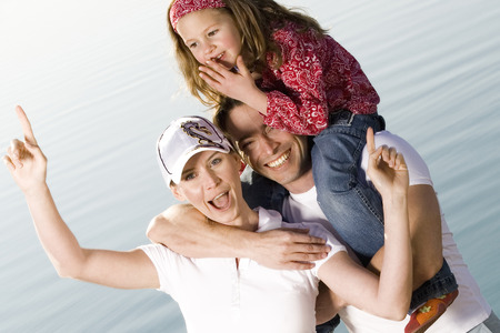 Man Standing With Carrying Daughter On Shoulder, Tilt View LANG_EVOIMAGES