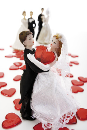 Wedding Couple Figurines On Red Hearts, Close-Up LANG_EVOIMAGES