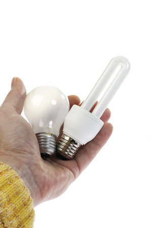 resourceful: Man Holding Energy Saving Lamp And Electric Bulb, Close-Up