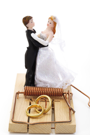 Wedding Couple Figurines Standing On Mouse Trap, Close-Up LANG_EVOIMAGES