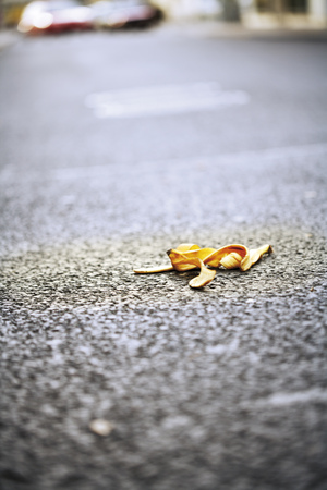 Banana Peel Lying On Street LANG_EVOIMAGES