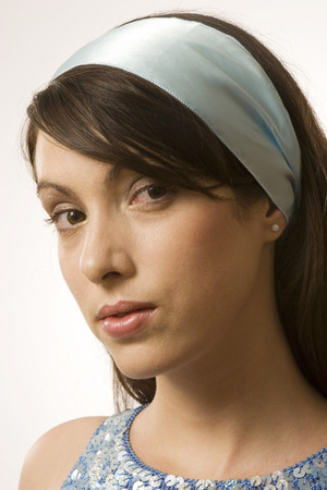 Young Woman Wearing Hair Band, Portrait, Close-Up LANG_EVOIMAGES