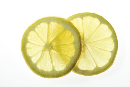 citrons: Lemon Slices, Close-Up LANG_EVOIMAGES