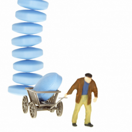 Man Pulling Trolley With Pills Piled Up