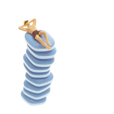 Man In Trunks Sunbathing On A Stack Of Pills
