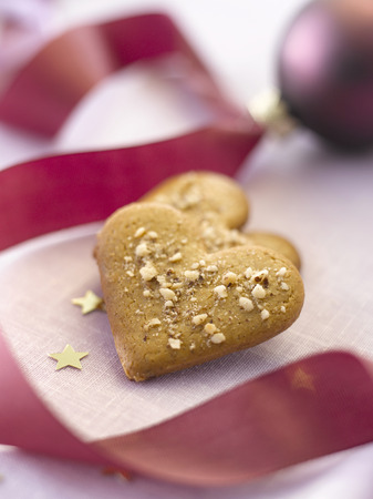 heartshaped: Heart-Shaped Cookies, Beside A Christmas Ball With Pink Ribbon LANG_EVOIMAGES