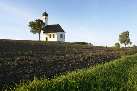 Germany, Bavaria, Chapel With Onion Spire On A Bank And Fields