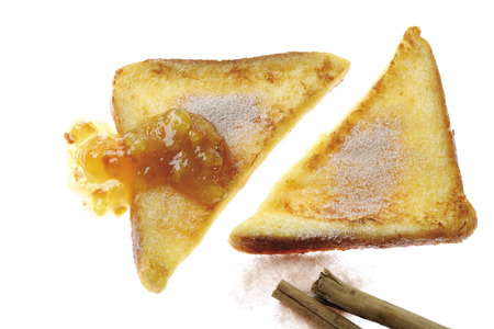 Two Slices Of French Toast With Cinnamon Sugar And Jam