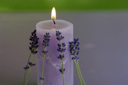 Burning Lavender Candle With Flowers, Close-Up