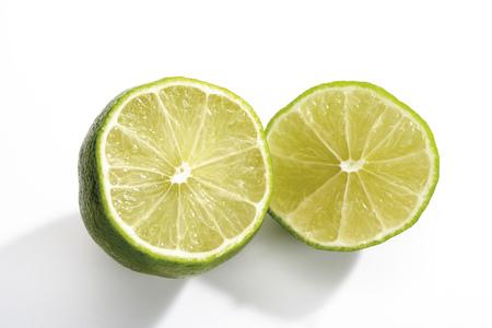 citrons: Sliced Lime Fruits, Close-Up LANG_EVOIMAGES