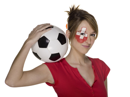 Woman With Swiss Flag Painted On Face, Holding Football On Shoulder LANG_EVOIMAGES