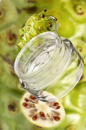 crucible: Noni Cosmetics, Fresh Fruits In Background, Close-Up
