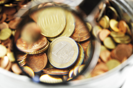Pot Of Euro Coins Under Magnifying Glass, Close-Up