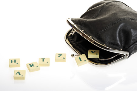 joblessness: Scrabble Tiles Writing Hartz Iv And Purse LANG_EVOIMAGES