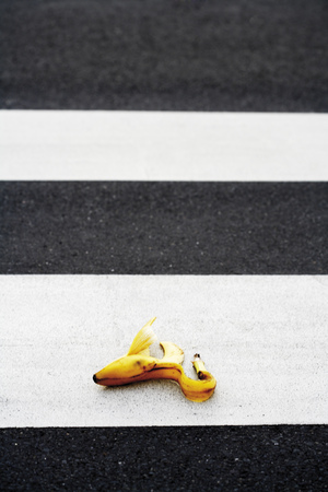 Banana Peel Lying On Crosswalk