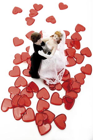 Wedding Couple Figurines Dancing Over Red Hearts, Elevated View LANG_EVOIMAGES