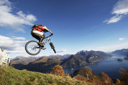 devote: Germany, Bavaria, Man Performing Jump On Bicycle