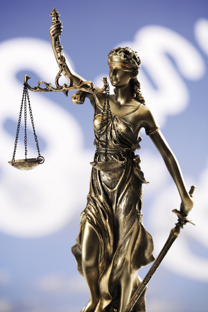 Justitia Figurine In Front Of Paragraphes, Close-Up
