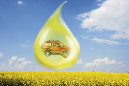 Oil Drop With Car Above Rape Field (Digital Composite)