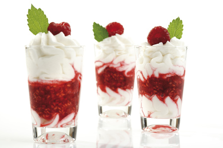 afters: Raspberries With Whipped Cream In Glass, Close-Up