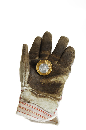 joblessness: Euro Coin On Working Glove, Close-Up