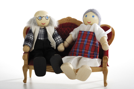 Two Puppets Sitting On Sofa, Close-Up