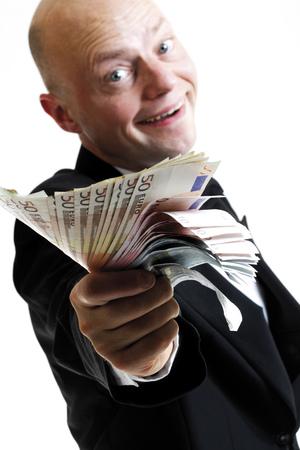 jubilating: Man Showing Banknotes LANG_EVOIMAGES
