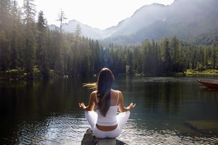 Woman Exercising Yoga At Lake LANG_EVOIMAGES