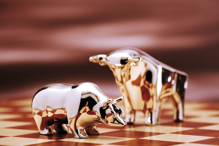perilous: Bull And Bear Figurine On Chessboard, Close-Up LANG_EVOIMAGES