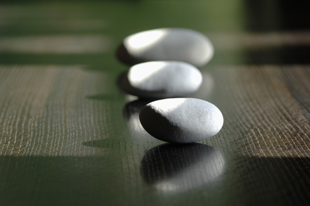 Pebbles On Table, Close-Up LANG_EVOIMAGES