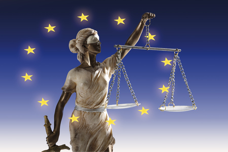 Justitia Figurine In European Flag, Close-Up LANG_EVOIMAGES