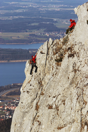 expanse: Germany, Bavaria, Two Persons Climbing On Rock Face
