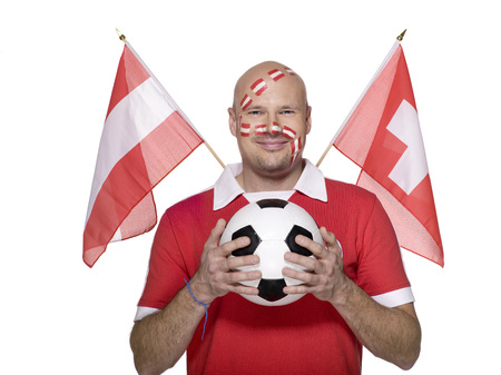 Man With Austrian Flag Painted On Face, Holding Football, Flags Aside LANG_EVOIMAGES