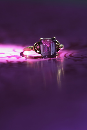 Ring On Purple Cloth, Close-Up