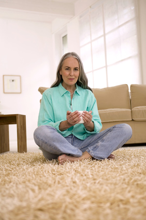 looking for love: Mature Woman Holding Cup Of Tea, Portrait