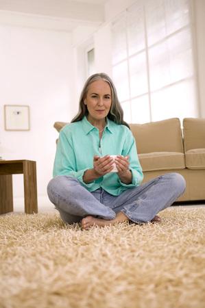 Mature Woman Holding Cup Of Tea, Portrait