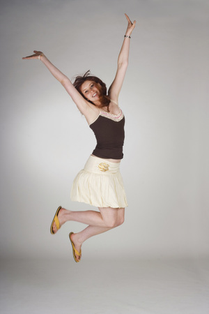 Young Woman Jumping, Arms Up