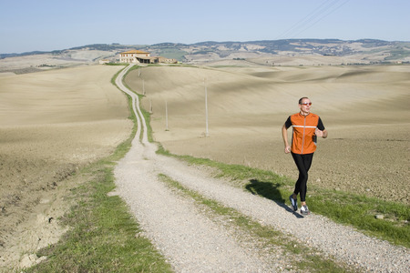Italy, Tuscany, Man Jogging LANG_EVOIMAGES
