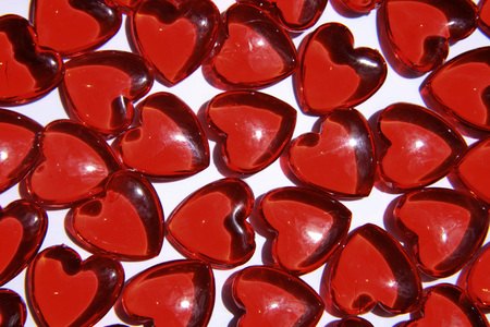 Red Heart-Shaped Glass Objects, Close-Up LANG_EVOIMAGES