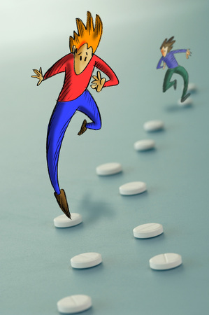 Figurines Jumping Over Tablets