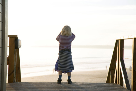 finding out: Portugal, Algarve, Girl (5-7) Standing At Beach, Rear View